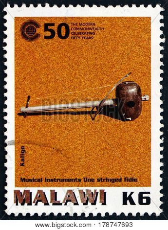 MALAWI - CIRCA 2000: a stamp printed in Malawi shows Kaligo African Musical Instrument circa 2000