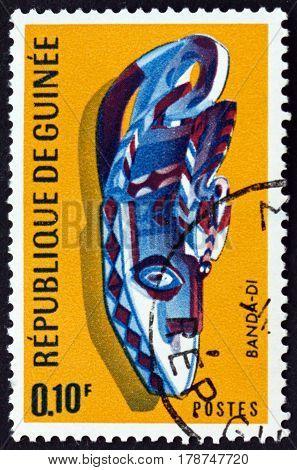 GUINEA - CIRCA 1967: a stamp printed in Guinea shows Small Banda Mask Kanfarade Boke Region circa 1967