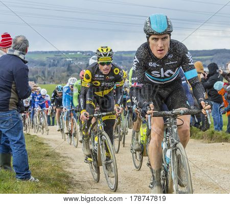 VendomeFrance- March 72016:The French cyclist Sylvain Chavanel of Direct Energie Team riding in the peloton on a dirty roadTertre de la Motte in Vendome during the first stage of Paris-Nice 2016.