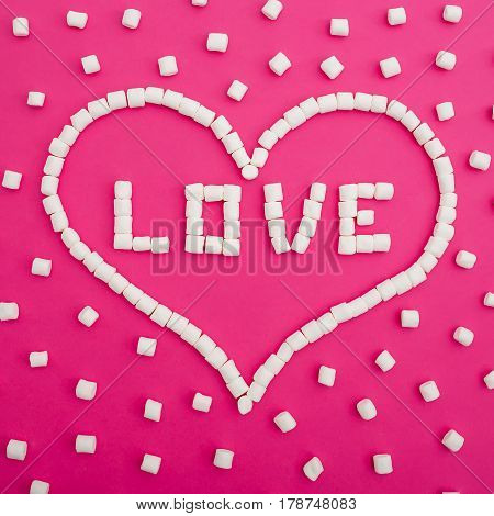 Marshmallows isolated on pink background. Word