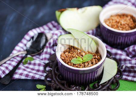 Homemade delicious apple crumble crisp dessert on table