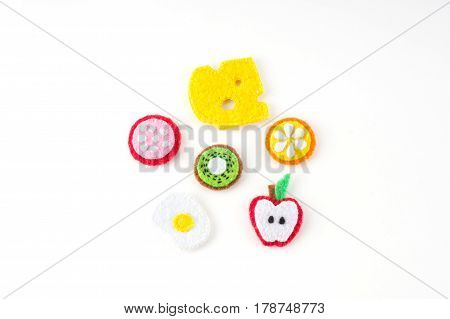 Handmade Toy In The Form Of Fruits And Food Made Of Felt . Close-up Of Crafts With Embroidery