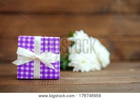 Gift and flowers. The concept of Mother's Day birthday March 8.