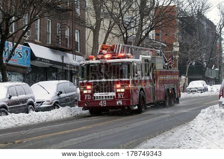 BRONX NEW YORK - MARCH 14: Fire engine in traffic during snow storm. Taken March 14 2017 in New York.