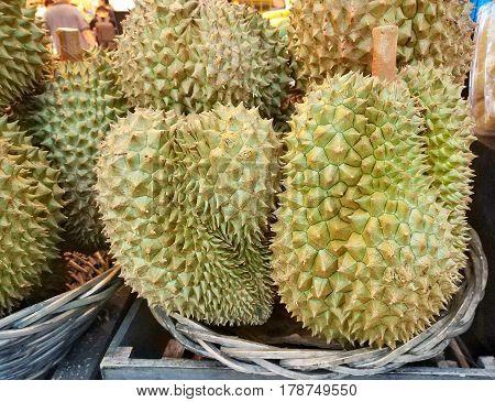 Durian fruit sale in farm market, Thailand Food background