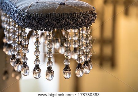 the decoration of the armrest on the chair. hanging glass icicles.