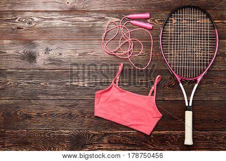 Badminton racket and tank top. Sport is life.