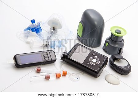 Diabetic items - Diabetes care, concept, test, monitor, background: Education about items to control diabetes: New modern Sensor-Augmented insulin pump, blood sugar meter and glucose sensor with set