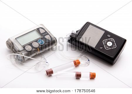 Modern Diabetic items - Diabetes care, concept, test, monitor, background: Education about items to control diabetes: New modern high-end insulin pump versus (vs) old basic pump