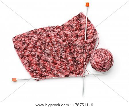 Top view of knitting with needles and yarn ball isolated on white