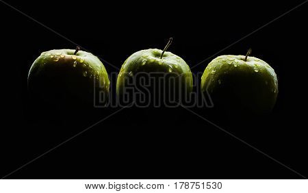 fresh red apple with droplets of water against black background diet eat food reflection drops