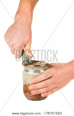 Hands A Can Opener Open A Jar Of Pate