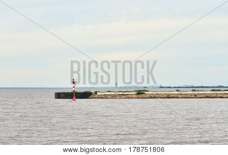 View of the pier and the Gulf of Finland in Strelna on the outskirts of St. Petersburg at cloud summer day. poster