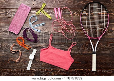 Timer, racket and tank top. Simple health life.