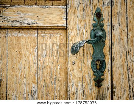 part of old wooden door with door knob