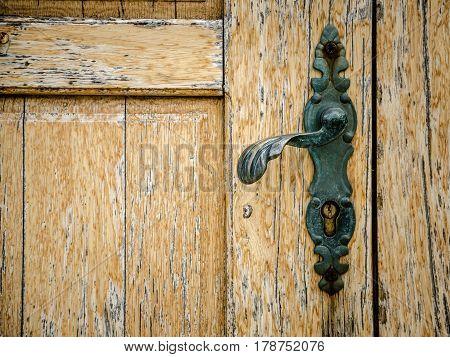 part of old wooden door with door knob