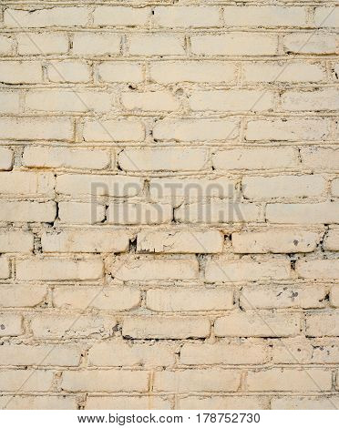 Background of old painted brick wall. Old bright brick wall texture. Brick wall painted in white