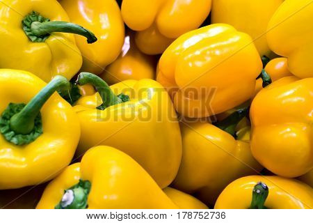 Bunch Of Yellow Peppers In A Greengrocery