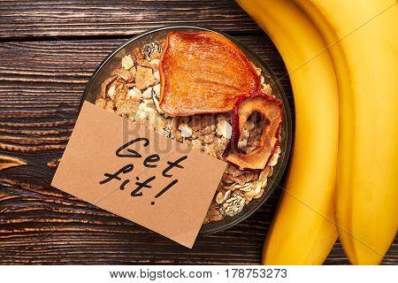 Bananas and muesli in bowl. Start living your dreams.