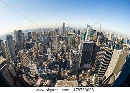 New York City, United States of America - March 24: Manhattan downtown skyline with Empire State Building and skyscrapers seen from Top of the Rock observation deck on March 24, 2015.