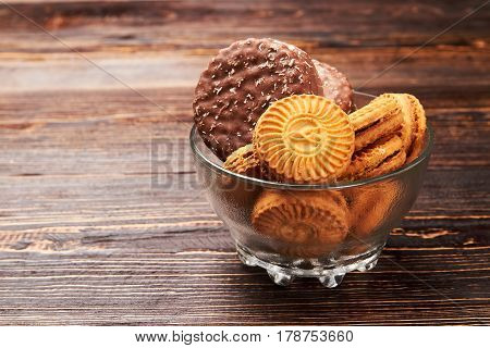 Cookies in glass bowl. Harmful effects of sugar.
