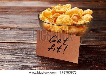 Cornflakes on wooden background. Healthy breakfast ideas.