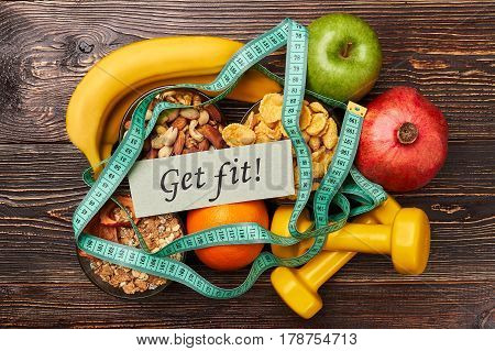 Apple, bananas, nuts and dumbbells. Take care of your health.
