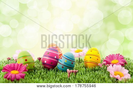 colorful eggs and flowers. Easter background, Easter egg hunting