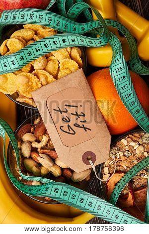 Orange, label and cereals. Get fit program.