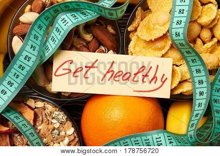 Nuts, cornflakes and orange. Healthy living challenge.