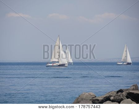 Luxury yachts in Mediterranean sea - Sailing regatta near sorrento, Italy, telephoto