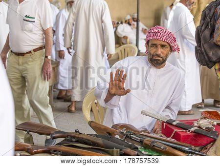 Nizwa Oma 24th March 2017: omani men selling guns at Nizwa market