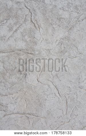 gray stone or rock pattern background and texture