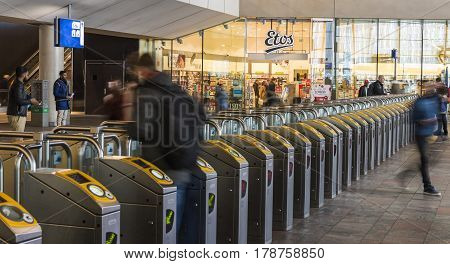Rotterdam The Netherlands - March 10 2017: Travelers at the gates for OV Chip tickets in the railway station of Rotterdam in the Netheralnds.