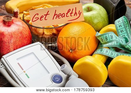 Tonometer, fruits and measuring tape. Spend life happy.