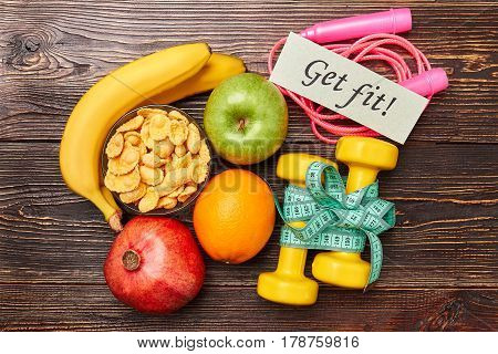 Cornflakes, fruits and sport equipment. Every workout counts.