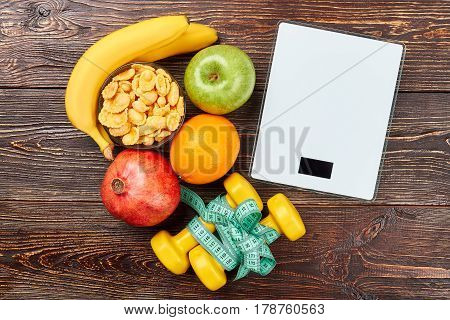 Scales, fruits, cornflakes and dumbbells. Be healthy and happy.