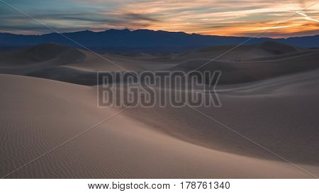 Waves Of Sand On Top Of The Dunes. Sunrise. Desert In Mesquite Flat, Death Valley, Usa.