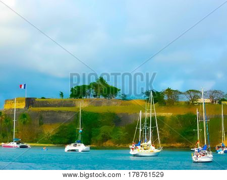 Old Fort in the capital of Fort de France, Martinique, with boats moored in the harbor below. Image blurred in postproduction