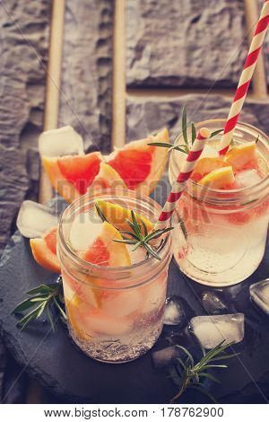 A Refreshing Summer Drink With Rosemary And Grapefruit On A Stone Background. The Concept Of A Healt