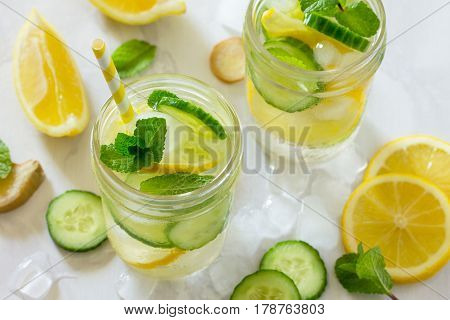 Water Sassi. Refreshing Summer Drink With Lemon, Ginger, Fresh Cucumber And Mint. The Concept Of Hea