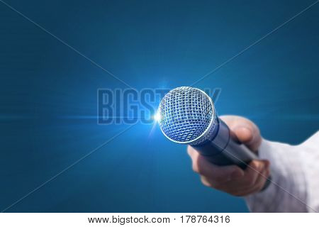 Female Hand With Microphone .