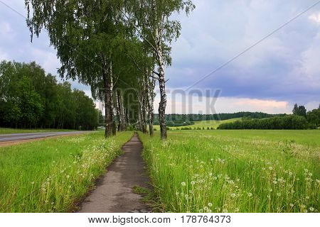 Field with clouds. Bad weather. Beautiful nature in Belarus. Summer in belarus. Dark clouds