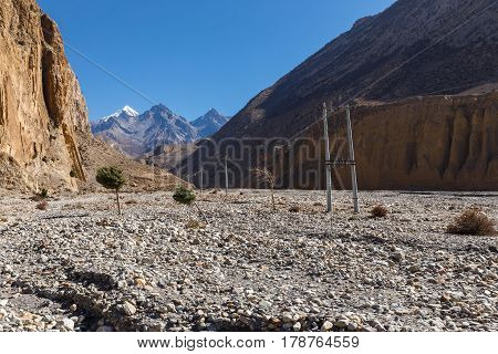 Power line in the mountains, the Himalayas, Lower Mustang, Nepal