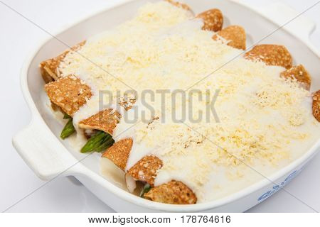 Quinoa crepes preparation :  Quinoa crepes with white sauce and parmesan cheese