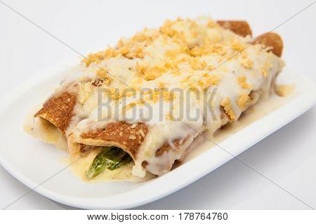 Quinoa crepes preparation :  Gratin quinoa crepes served on white dish