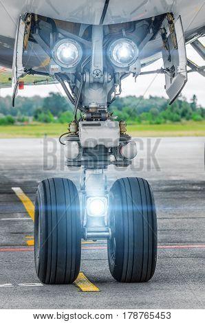 Aircraft landing gear and landing lights lights on.