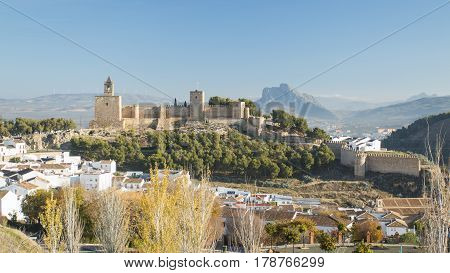 Ancient city on mountain in sunlight with clear blue sky on. Antequera Malaga