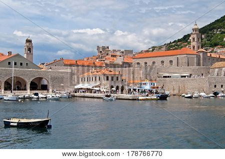 DUBROVNIK, CROATIA - JUNE 28, 2010: Locals and tourists are are arrived by the boat to Dubrovnik