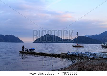 One person fishing on pier in marmaris beach